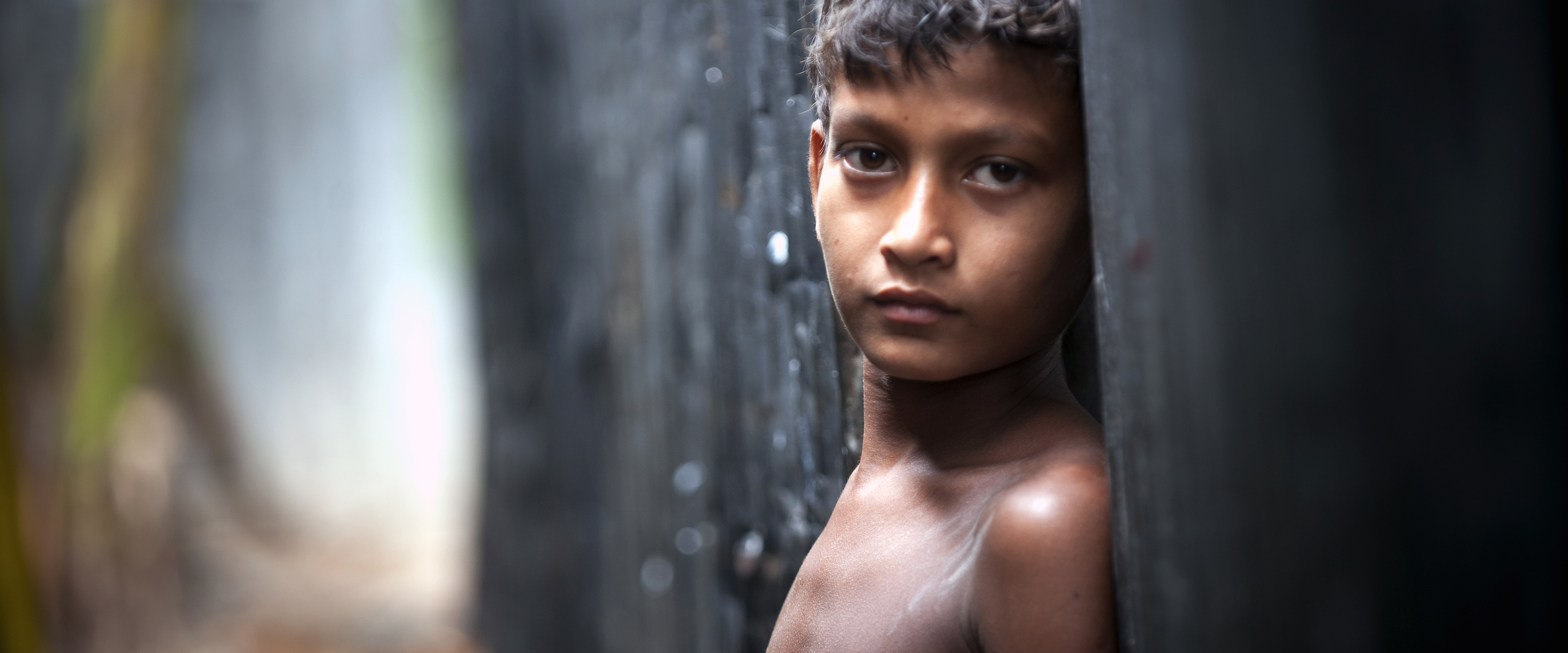 13 June 2010-Dhaka, Bangladesh-A child in Karial slum, one of the urban slum in Dhaka: Half the world's population (World-6.75 billion as of 2008) lives in cities and towns. One billion people, one out of three urban dwellers are living in slum conditions. (UN Millennium Development Goals Report 2007, UNESCAP 2009) Photo Credit:Kibae Park/Sipa Press